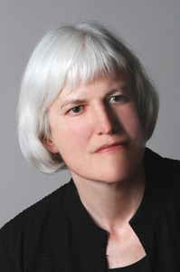 Picture shows Kleege, slightly tilted to the left and slightly facing right. She has silver hair worn in bangs and cut to just below her ears. She wears a black, collarless shirt. [end of description]